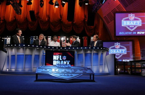 NEW YORK - APRIL 26:  The ESPN broadcast team of (L-R) Mel Kiper, Chris Mortensen,Keyshawn Johnson, Steve Young and Chris Berman work the 2008 NFL Draft on April 26, 2008 at Radio City Music Hall in New York City.  (Photo by Jim McIsaac/Getty Images)