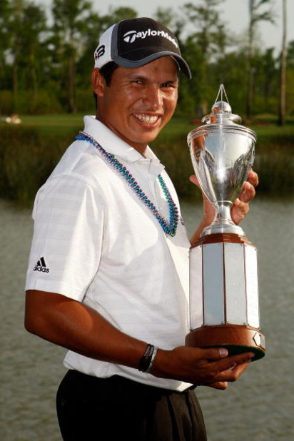 AVONDALE, LA - MARCH 30:  Andres Romero holds the winner's trophy after the final round of the Zurich Classic of New Orleans on March 30, 2008 at TPC Louisiana in Avondale, Louisiana.  Romero finished the day at 13 under-par.  (Photo by Chris Graythen/Get