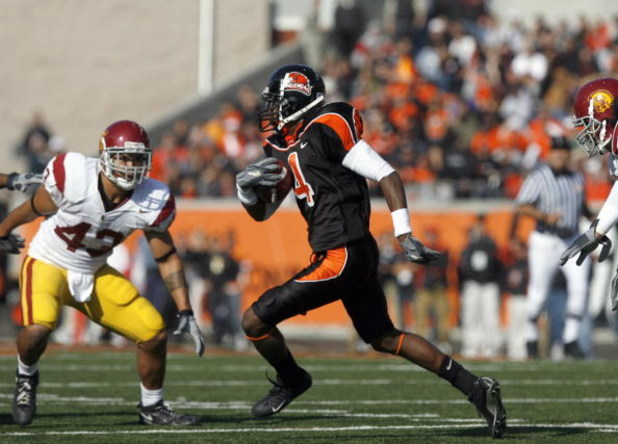 CORVALLIS, OR - OCTOBER 28: Coye Francies #4 of the Oregon State Beavers carries the ball against Kaluka Maiava#43 of the Southern California Trojans at Reser Stadium on October 28, 2006 in Corvallis, Oregon. The Beavers defeated the Trojans 33-31. (Photo