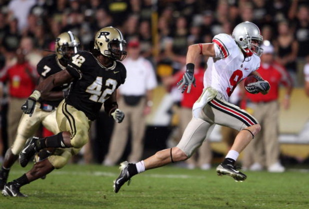WEST LAFAYETTE, IN - OCTOBER 06:  Brian Hartline #9 of the Ohio State Buckeyes runs away from Anthony Heygood #42 of the Purdue Boilermakers during the game on October 6, 2007 at Ross-Ade Stadium in West Lafayette, Indiana.  (Photo by Andy Lyons/Getty Ima