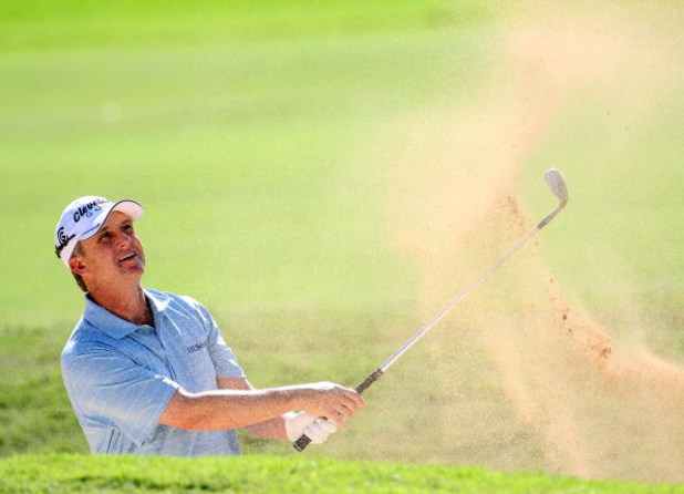 HONOLULU - JANUARY 18:  David Toms watches his shot from a bunker during the final round of the Sony Open at Waialae Country Club on January 18, 2009 in Honolulu, Hawaii.  (Photo by Sam Greenwood/Getty Images)