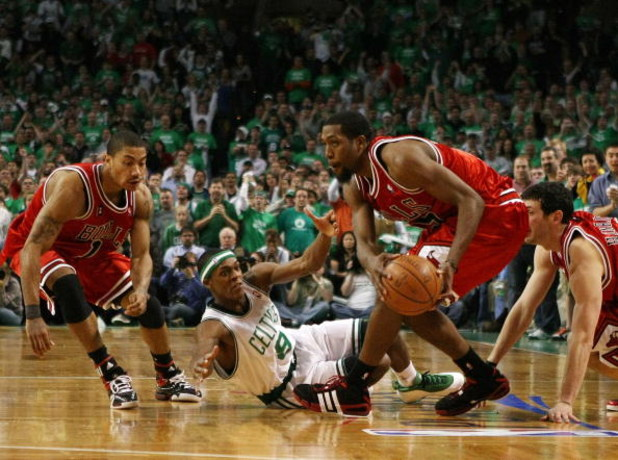 BOSTON - APRIL 18:  John Salmons #15 of the Chicago Bulls nabs the loose ball from Rajon Rondo #9 of the Boston Celtics as Derrick Rose #1 of the Bulls defends in Game One of the Eastern Conference Quarterfinals during the 2009 NBA Playoffs at TD Banknort