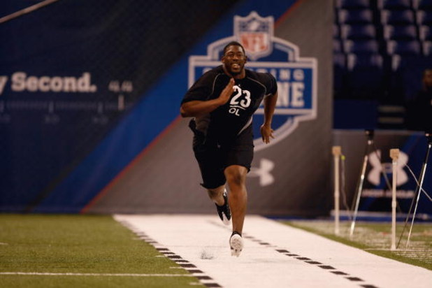 INDIANAPOLIS, IN - FEBRUARY 21:  Offensive lineman Tyronne Green of Auburn runs the 40 yard dash during the NFL Scouting Combine presented by Under Armour at Lucas Oil Stadium on February 21, 2009 in Indianapolis, Indiana. (Photo by Scott Boehm/Getty Imag
