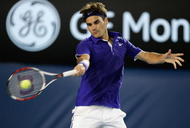 MELBOURNE, AUSTRALIA - JANUARY 27:  Roger Federer of Switzerland plays a forehand in his quarterfinal match against Juan Martin Del Potro of Argentina during day nine of the 2009 Australian Open at Melbourne Park on January 27, 2009 in Melbourne, Australi