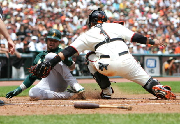 SAN FRANCISCO - JUNE 10:  Bengie Molina #1 of the San Francisco Giants tags out Nick Swisher #33 of the Oakland Athletics on a fielders choice hit by Dan Johnson in the fourth inning on June 10, 2007 at AT&T Park in San Francisco, California.  (Photo by J