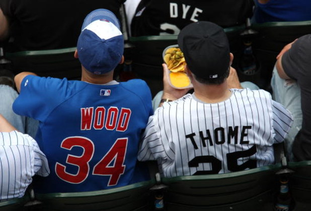 CHICAGO - JUNE 28:  A fan of the Chicago Cubs wearing a Kerry Wood #34 jersey sits next to a fan of the Chicago White Sox wearing a Jim Thome #25 jersey at U.S. Cellular Field on June 28, 2008 in Chicago, Illinois.  (Photo by Jonathan Daniel/Getty Images)