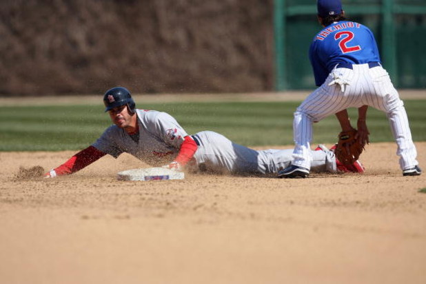 CHICAGO - APRIL 17:  Brian Barden #23 of the St. Louis Cardinals dives into second against Ryan Theriot #2 of the Chicago Cubs on April 17, 2009 at Wrigley Field in Chicago, Illinois. (Photo by Jonathan Daniel/Getty Images)