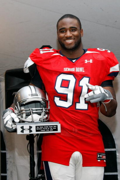 MOBILE, AL - JANUARY 24:  Robert Ayers #91 of the South Team accepts the Defensive Player of the game Trophy after defeating the North Team during the Under Armour Senior Bowl on January 24, 2009 at Ladd-Peebles Stadium in Mobile, Alabama. (Photo by Chris