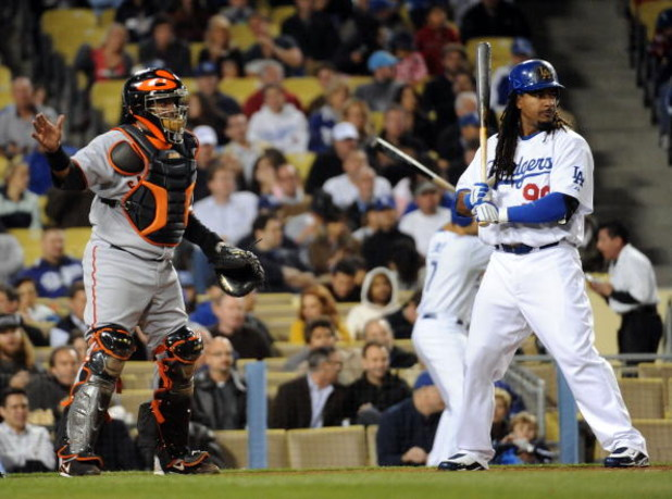 LOS ANGELES, CA - APRIL 16: Manny Ramirez #99 of the Los Angeles Dodgers takes an intentional walk from Bengie Molina #1 of the San Francisco Giants during the second inning at Dodger Stadium on April 16, 2009 in Los Angeles, California. (Photo by Harry H