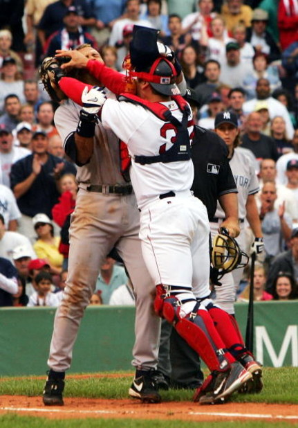 BOSTON - JULY 24:  Alex Rodriguez #13 of the New York Yankees gets into a fight with catcher Jason Varitek #33 of the Boston Red Sox after Rodriguez was hit by a pitch by pitcher Bronson Arroyo in the third inning on July 24, 2004 at Fenway Park in Boston