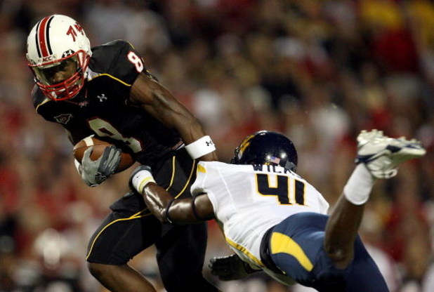 COLLEGE PARK, MD - SEPTEMBER 13:  Receiver Darrius Heyward-Bey #8 of the Maryland Terrapins evades Eric Wicks #41 of the West Virginia Mountaineers after making a reception during the 1st quarter of the game on September 13, 2007 at Byrd Stadium in Colleg