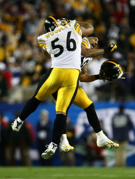 TAMPA, FL - FEBRUARY 01:  LaMarr Woodley #56 and Larry Foote #50 of the Pittsburgh Steelers celebrate on the field against the Arizona Cardinals during Super Bowl XLIII on February 1, 2009 at Raymond James Stadium in Tampa, Florida. The Steelers won the g