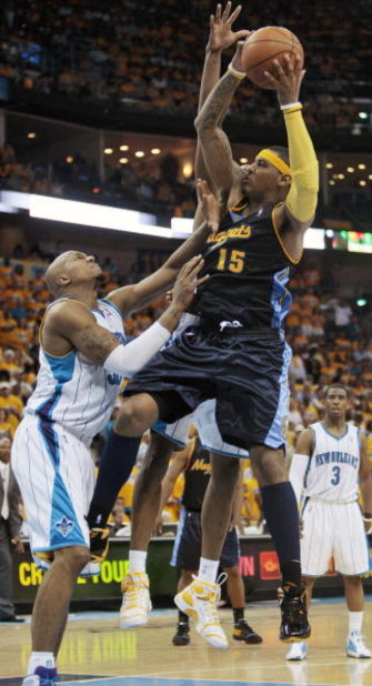 NEW ORLEANS - APRIL 25:  Carmelo Anthony #15 of the Denver Nuggets drives to the basket against David West #30 of the New Orleans Hornets during Game Three of the Western Conference Quarterfinals during the 2009 NBA Playoffs at New Orleans Arena on April