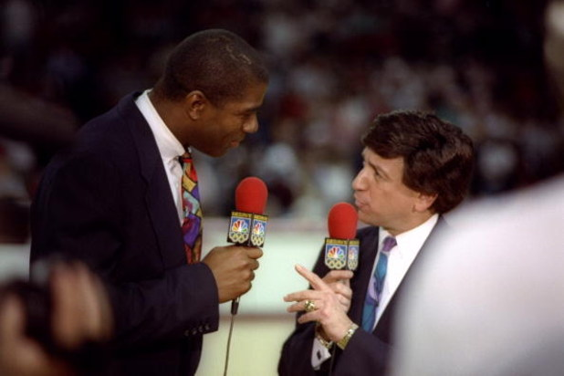 17 May 1992: NBC sportscaster Marv Albert and Earvin Magic Johnson talk during a game between the Chicago Bulls and the New York Knicks at the United Center in Chicago, Illinois.