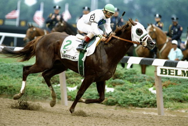 Pat Day rides Tabasco Cat to victory in the Belmont Stakes at Belmont Park in Belmont, New York.
