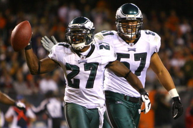 CHICAGO - SEPTEMBER 28:  (L-R) Quintin Mikell #27 and Chris Gocong #57 of the Philadelphia Eagles celebrate after Mikell intercepted a pass in the third quarter against the Chicago Bears at Soldier Field on September 28, 2008 in Chicago, Illinois.  (Photo