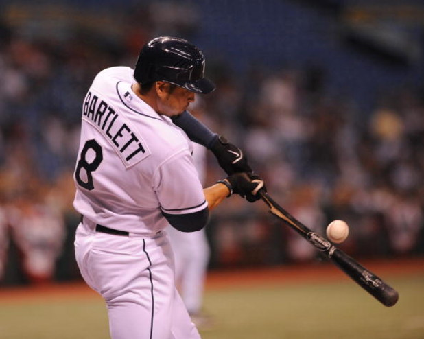 ST. PETERSBURG, FL - APRIL 16:  Infielder Jason Bartlett #8 of the Tampa Bay Rays breaks a bat against the Chicago White Sox on April 16, 2009 at Tropicana Field in St. Petersburg, Florida.  (Photo by Al Messerschmidt/Getty Images)