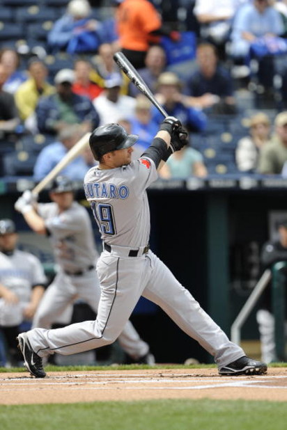 KANSAS CITY, MO - APRIL 30:  Marco Scutaro #19 of the Toronto Blue Jays connects for a first-inning home run off Kyle Davies of the Kansas City Royals on April 30, 2009 at Kauffman Stadium in Kansas City, Missouri. (Photo by G. Newman Lowrance/Getty Image
