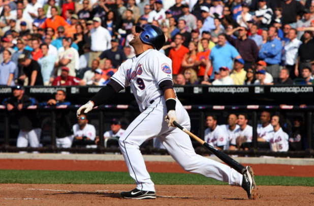 NEW YORK - APRIL 29:  Pinch hitter Omir Santos #9 of the New York Mets pops up for the final out of the game with the bases loaded against the Florida Marlins on April 29, 2009 at Citi Field in the Flushing neighborhood of the Queens borough of New York C