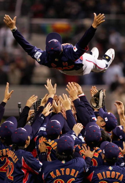 SAN DIEGO - MARCH 20:  Manager Sadaharu Oh of Team Japan is thrown up into the air by teammates after defeating Team Cuba in the Final game of the World Baseball Classic at Petco Park on March 20, 2006 in San Diego, California.  Japan defeated Cuba 10-6 t