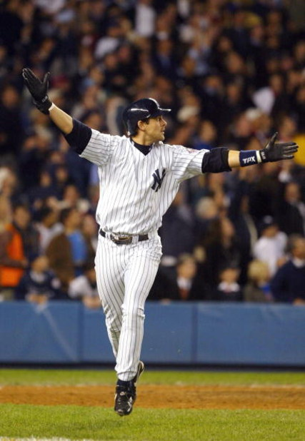 BRONX, NY - OCTOBER 16:  Aaron Boone #19 of the New York Yankees celebrates after hitting the game-winning home run in the bottom of the eleventh inning against the Boston Red Sox during game 7 of the American League Championship Series on October 16, 200