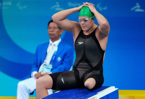 BEIJING, CHINA - SEPTEMBER 14: Natalie du Toit of South Africa gives the thumbs up after  winning her 5th Gold Medal in the 50m Freestyle S9 during day 8 of the 2008 Beijing Paralympic Games September 14, 2008 in Beijing, China. (Photo by Duif du Toit /Ga