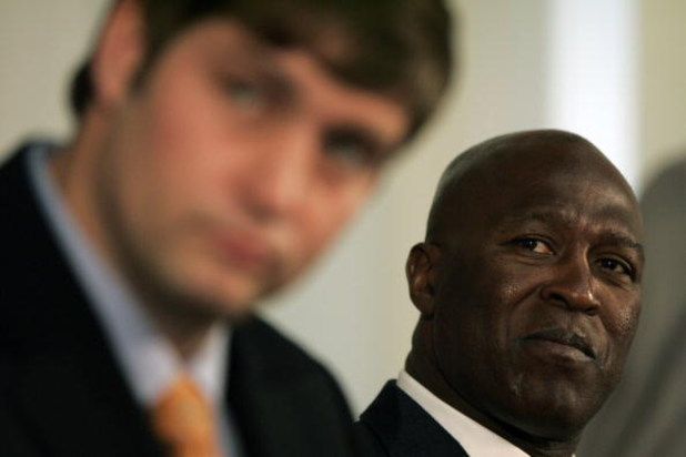 LAKE FOREST, IL - APRIL 3:  Chicago Bears head coach Lovie Smith looks on as new quarterback Jay Cutler talks to the media  during a press conference on April 3, 2009 at Halas Hall in Lake Forest, Illinois. (Photo by Jim Prisching/Getty Images)