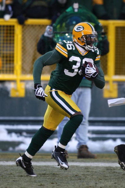 GREEN BAY, WI - DECEMBER 28: Nick Collins #36 of the Green Bay Packers runs with the ball after making an interception against the Detroit Lions on December 28, 2008 at Lambeau Field in Green Bay, Wisconsin. The Packers defeated the Lions 31-21. (Photo by