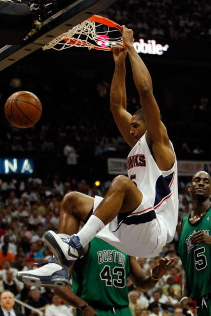 ATLANTA - MAY 02:  Al Horford #15 of the Atlanta Hawks dunks the ball over Kevin Garnett #5 of the Boston Celtics in Game Six of the Eastern Conference Quarterfinals during the 2008 NBA Playoffs at Phillips Arena on May 2, 2008 in Atlanta Georgia. The Haw