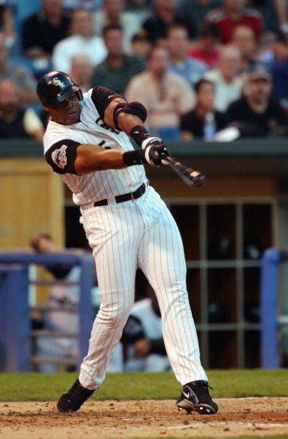 CHICAGO - SEPTEMBER 3:  Designated hitter Frank Thomas #35 of the Chicago White Sox swings at a pitch against the Boston Red Sox during a game on September 3, 2003 at U.S. Cellular Field in Chicago, Illinois. The Red Sox defeated the White Sox 5-4 in 10 i