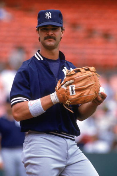 OAKLAND, CA - 1990:  Don Mattingly #23 of the New York Yankees looks on as he stand on the field during practice prior to a 1990 season game against the Oakland Athletics at Oakland-Alameda County Coliseum in Oakland, California. (Photo by Otto Greule Jr/