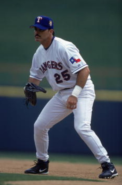 3 Apr 2001:  Rafael Palmeiro #25 of the Texas Rangers moves to get the ball during the game against the Anaheim Angels at The Ballpark in Arlington, Texas.  The Rangers defeated the Angels 3-2.Mandatory Credit: Scott Halleran  /Allsport