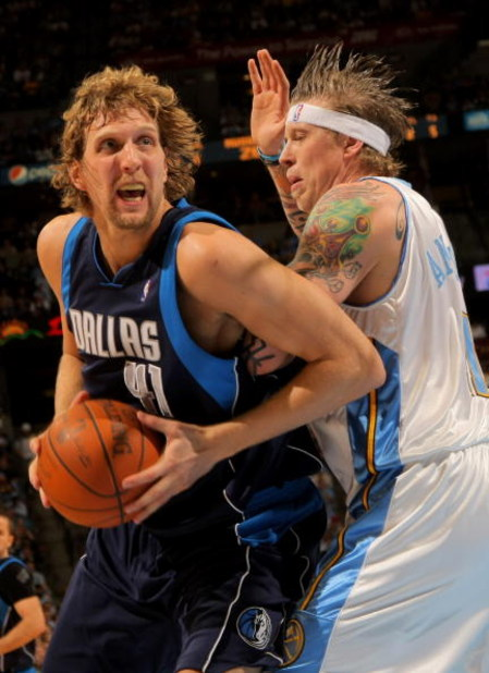 DENVER - MAY 05:  Dirk Nowitzki #41 of the Dallas Mavericks makes a move around the defense of Chris Andersen #11 of the Denver Nuggets in Game Two of the Western Conference Semifinals during the 2009 NBA Playoffs at Pepsi Center on May 5, 2009 in Denver,