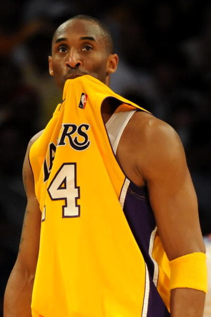 LOS ANGELES, CA - MAY 06:  (EDITORS NOTE: THIS IMAGE HAS BEEN RE-CROPPED) Kobe Bryant #24 of the Los Angeles Lakers reacts in the second quarter against the Houston Rockets in Game Two of the Western Conference Semifinals during the 2009 NBA Playoffs at S