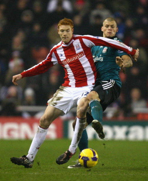 STOKE, UNITED KINGDOM - JANUARY 10:  Dave Kitson of Stoke City battles for the ball with Martin Skrtel of Liverpool during the Barclays Premier League match between Stoke City and Liverpool at the Britannia Stadium on January 10, 2009 in Stoke, England. (