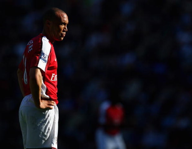 WIGAN, ENGLAND - APRIL 11: Mikael Silvestre of Arsenal in action during the Barclays Premier League match between Wigan Athletic and Arsenal at The JJB Stadium on April 11, 2009 in Wigan, England.  (Photo by Laurence Griffiths/Getty Images)