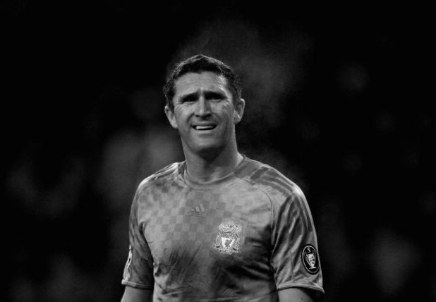 EINDHOVEN, NETHERLANDS - DECEMBER 09: (EDITORS NOTE: THIS IMAGE HAS BEEN CONVERTED TO BLACK AND WHITE)  Robbie Keane of Liverpool looks on during the UEFA Champions League Group D match between PSV Eindhoven and Liverpool at the Philips Stadium on Decembe