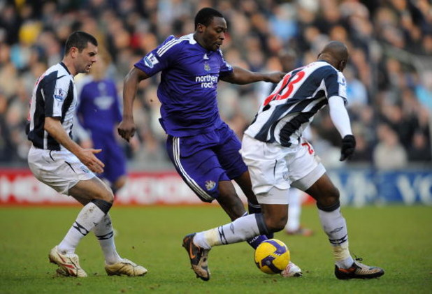 WEST BROMWICH, UNITED KINGDOM - FEBRUARY 07:  Shola Ameobi of Newcastle battles with Paul Robinson and Abdoulaye Meite of West Brom during the Barclays Premier League match between West Bromwich Albion and Newcastle United at The Hawthorns on February 7,