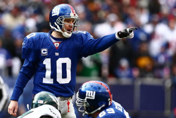 EAST RUTHERFORD, NJ - JANUARY 11:  Eli Manning #10 of the New York Giants gestures against the Philadelphia Eagles during the NFC Divisional Playoff Game on January 11, 2009 at Giants Stadium in East Rutherford, New Jersey.  (Photo by Chris McGrath/Getty