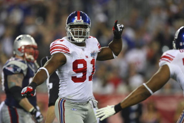 GLENDALE, AZ - FEBRUARY 03:  Defensive end Justin Tuck #91 of the New York Giants reacts after a sack in the second quarter of Super Bowl XLII against the New England Patriots on February 3, 2008 at the University of Phoenix Stadium in Glendale, Arizona.