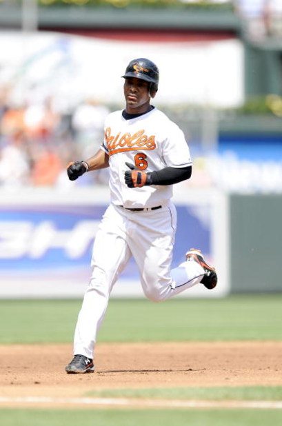 BALTIMORE - AUGUST 24:   Melvin Mora #6 of the Baltimore Orioles rounds the bases after hitting a home run in the first inning against the New York Yankees August 24, 2008 at Camden Yards in Baltimore, Maryland.  (Photo by Greg Fiume/Getty Images)
