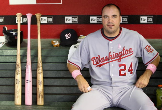PHOENIX - MAY 10:  Nick Johnson #24 of the Washington Nationals sits in the dugout next to a pink bat in honor of Mother's day before the major league baseball game against the Arizona Diamondbacks at Chase Field on May 10, 2009 in Phoenix, Arizona.  (Pho