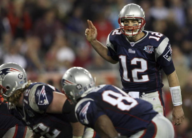 GLENDALE, AZ - FEBRUARY 03:  Tom Brady #12 of of the New England Patriots calls out from under center in the fourth quarter of Super Bowl XLII against the New York Giants on February 3, 2008 at the University of Phoenix Stadium in Glendale, Arizona.  (Pho