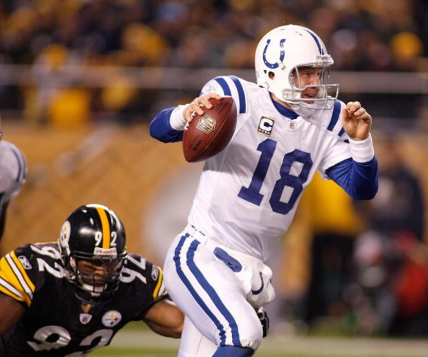 PITTSBURGH - NOVEMBER 09: Peyton Manning #18 of the Indianapolis Colts scrambles away from James Harrison #92 of the Pittsburgh Steelers on November 9, 2008 at Heinz Field in Pittsburgh, Pennsylvania.  (Photo by Rick Stewart/Getty Images)