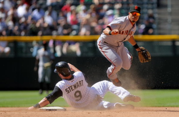 DENVER - MAY 07:  Second baseman Emmanual Burriss #7 of the San Francisco Giants gets a force out in Ian Stewart #9 of the Colorado Rockies at second on a grounder by Clint Barmes to Pablo Sandoval in the seventh inning of MLB action at Coors Field on May