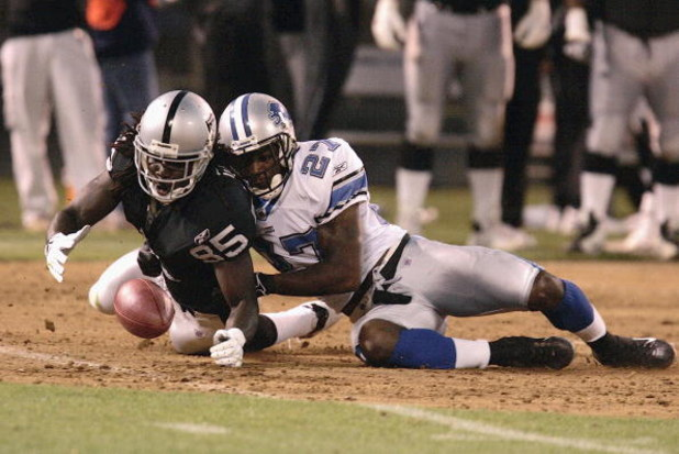 OAKLAND, CA - AUGUST 25: Oakland Raiders Doug Gabriel #85 dives for the ball with Detroit Lions safety Daniel Bullocks  #27in the first half as the Oakland Raiders host the Detroit Lions at McAfee Stadium on August 25, 2006 in Oakland, California. (Photo