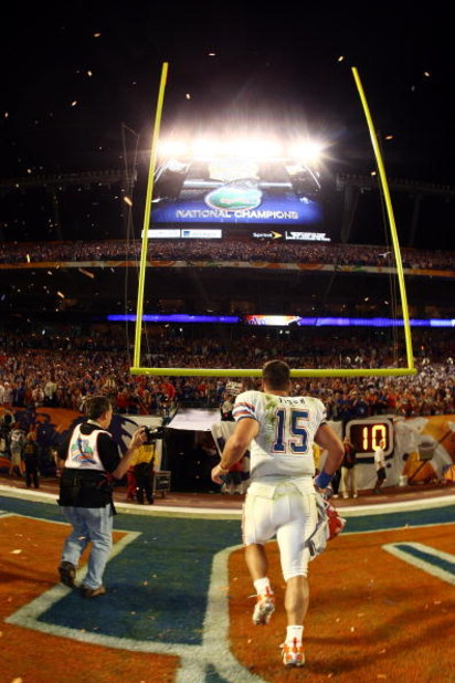 MIAMI - JANUARY 08:  Quarterback Tim Tebow #15 of the Florida Gators runs off of the field after defeating the Oklahoma Sooners in the FedEx BCS National Championship Game at Dolphin Stadium on January 8, 2009 in Miami, Florida. The Gators won the game by