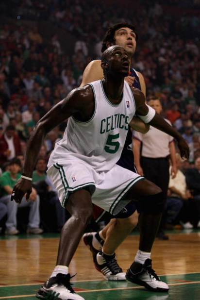 BOSTON - APRIL 20:  Kevin Garnett #5 of the Boston Celtics and Zaza Pachulia #27 of the Atlanta Hawks wait under the basket in Game One of the Eastern Conference Quarterfinals during the 2008 NBA Playoffs on April 20, 2008 at the TD Banknorth Garden in Bo