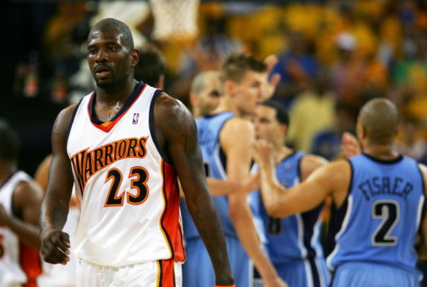 OAKLAND, CA - MAY 13:  Jason Richardson #23 of the Golden State Warriors walks away from members of the Utah Jazz celebrating a point in Game 4 of the Western Conference Semifinals during the 2007 NBA Playoffs on May 13, 2007 at Oracle Arena in Oakland, C