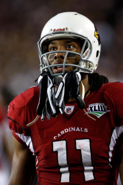 TAMPA, FL - FEBRUARY 01:  Larry Fitzgerald #11 of the Arizona Cardinals looks on against the Pittsburgh Steelers during Super Bowl XLIII on February 1, 2009 at Raymond James Stadium in Tampa, Florida.  (Photo by Jamie Squire/Getty Images)
